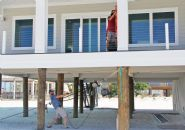 Moreland modern piling home on Navarre Beach by Acorn Fine Homes - Thumb Pic 15