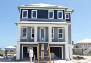 Walker piling home in Navarre Beach by Acorn Fine Homes