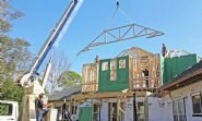 Seidel remodel in Pensacola by Acorn Fine Homes setting trusses - Thumb Pic 13