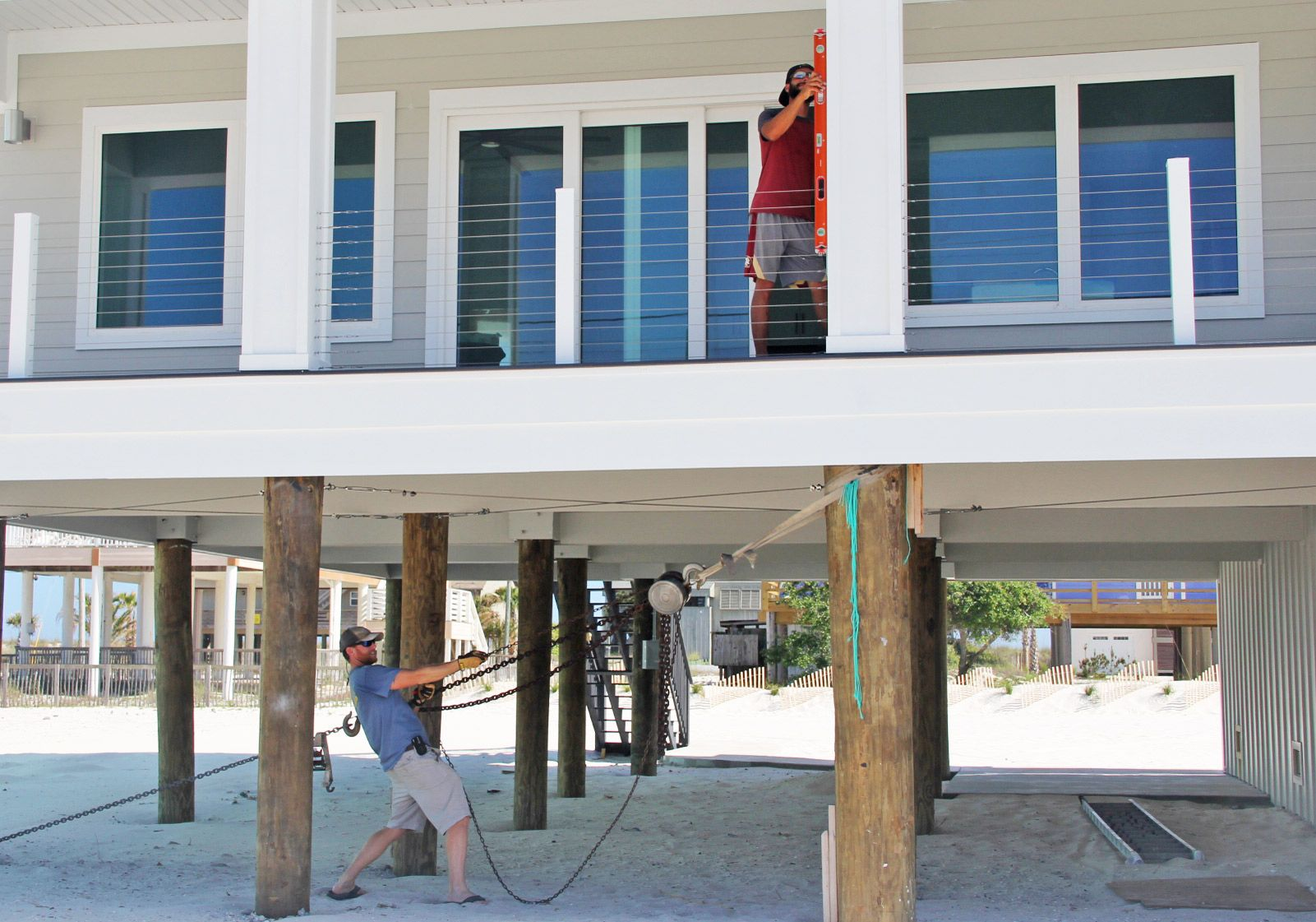Moreland modern piling home on Navarre Beach by Acorn Fine Homes
