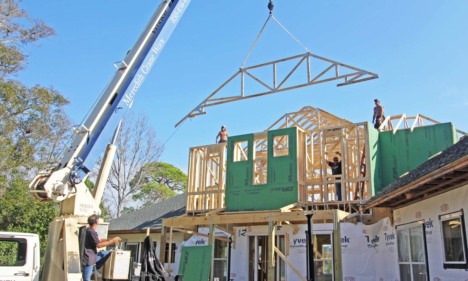 Seidel remodel in Pensacola by Acorn Fine Homes setting trusses